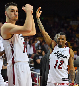 LAS CRUCES, NEW MEXICO - MARCH 05, 2020:  AJ Harris #12 of the New Mexico State Aggies gestures to the crowd during his team's game against the Cal Baptist Lancers at the Pan American Center on March 5, 2020 in Las Cruces, New Mexico. The Aggies defeated the Lancers 83-50 to complete a perfect 16-0 record in WAC play.  (Photo by Sam Wasson/bleedCrimson.net)