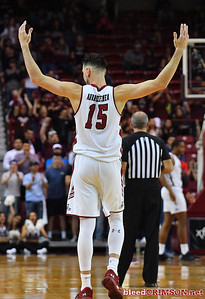 LAS CRUCES, NEW MEXICO - MARCH 05, 2020:  Ivan Aurrecoechea #15 of the New Mexico State Aggies gestures to the crowd after being subbed out for the final time during his team's game against the Cal Baptist Lancers at the Pan American Center on March 5, 2020 in Las Cruces, New Mexico. The Aggies defeated the Lancers 83-50 to complete a perfect 16-0 record in WAC play.  (Photo by Sam Wasson/bleedCrimson.net)