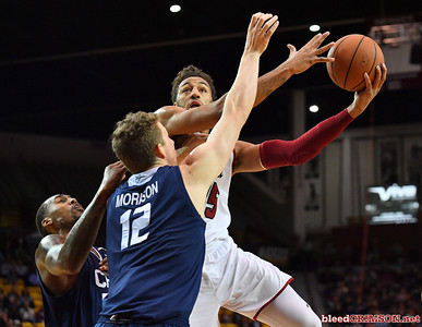 LAS CRUCES, NEW MEXICO - MARCH 05, 2020:  Johnny McCants #35 of the New Mexico State Aggies shoots against Brandon Boyd #15 of the Cal Baptist Lancers during their game at the Pan American Center on March 5, 2020 in Las Cruces, New Mexico. The Aggies defeated the Lancers 83-50 to complete a perfect 16-0 record in WAC play.  (Photo by Sam Wasson/bleedCrimson.net)