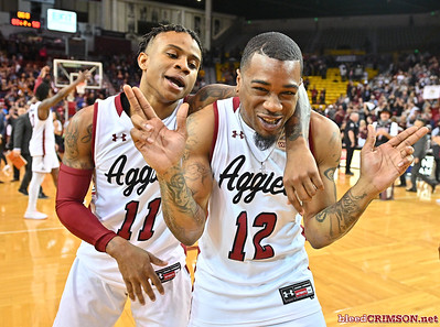 LAS CRUCES, NEW MEXICO - MARCH 05, 2020:  Evan Gilyard #11 and AJ Harris #12 of the New Mexico State Aggies celebrates on the court after his team's game against the Cal Baptist Lancers at the Pan American Center on March 5, 2020 in Las Cruces, New Mexico. The Aggies defeated the Lancers 83-50 to complete a perfect 16-0 record in WAC play.  (Photo by Sam Wasson/bleedCrimson.net)