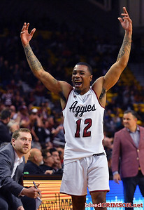 LAS CRUCES, NEW MEXICO - MARCH 05, 2020:  AJ Harris #12 of the New Mexico State Aggies reacts after Trevelin Queen #21 dunked against the Cal Baptist Lancers during their game at the Pan American Center on March 5, 2020 in Las Cruces, New Mexico. The Aggies defeated the Lancers 83-50 to complete a perfect 16-0 record in WAC play.  (Photo by Sam Wasson/bleedCrimson.net)