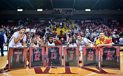 LAS CRUCES, NEW MEXICO - MARCH 05, 2020:  (L-R) Shunn Buchanan #1, AJ Harris #12, C.J. Bobbitt #13, Terrell Brown #3, Trevelin Queen #21 and Ivan Aurrecoechea #15 of the New Mexico State Aggies pose during their Senior Night ceremony after their game against the Cal Baptist Lancers at the Pan American Center on March 5, 2020 in Las Cruces, New Mexico. The Aggies defeated the Lancers 83-50.  (Photo by Sam Wasson/bleedCrimson.net)