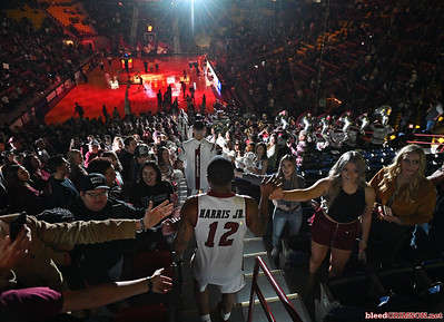 LAS CRUCES, NEW MEXICO - MARCH 05, 2020:  AJ Harris #12 of the New Mexico State Aggies high-fives fans as walks down through the student section before his team's game against the Cal Baptist Lancers at the Pan American Center on March 5, 2020 in Las Cruces, New Mexico. The Aggies defeated the Lancers 83-50 to complete a perfect 16-0 record in WAC play.  (Photo by Sam Wasson/bleedCrimson.net)