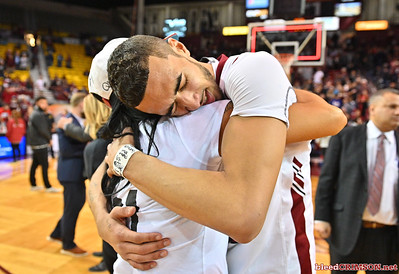 LAS CRUCES, NEW MEXICO - MARCH 05, 2020:  Trevelin Queen #21 of the New Mexico State Aggies hugs his mother, Nancy Yeaton, after his team's game against the Cal Baptist Lancers at the Pan American Center on March 5, 2020 in Las Cruces, New Mexico. The Aggies defeated the Lancers 83-50 to complete a perfect 16-0 record in WAC play.  (Photo by Sam Wasson/bleedCrimson.net)