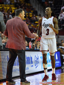 LAS CRUCES, NEW MEXICO - MARCH 05, 2020:  Terrell Brown #3 of the New Mexico State Aggies greets head coach Chris Jans after being subbed out during their game against the Cal Baptist Lancers at the Pan American Center on March 5, 2020 in Las Cruces, New Mexico. The Aggies defeated the Lancers 83-50 to complete a perfect 16-0 record in WAC play.  (Photo by Sam Wasson/bleedCrimson.net)
