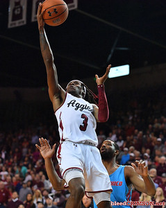 LAS CRUCES, NEW MEXICO - NOVEMBER 21, 2019:  Terrell Brown #3 of the New Mexico State Aggies shoots against JaQuan Lyle #5 of the New Mexico Lobos during their game at The Pan American Center on November 21, 2019 in Las Cruces, New Mexico. The Lobos defeated the Aggies 78-77.  (Photo by Sam Wasson/bleedCrimson.net)