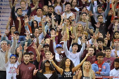 LAS CRUCES, NEW MEXICO - NOVEMBER 21, 2019:  New Mexico State Aggies fans hold up a 'Guns Up' sign with their hands during an Aggie free throw attempt during the team's game against the New Mexico Lobos at The Pan American Center on November 21, 2019 in Las Cruces, New Mexico. The Lobos defeated the Aggies 78-77.  (Photo by Sam Wasson/bleedCrimson.net)
