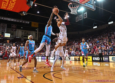 LAS CRUCES, NEW MEXICO - NOVEMBER 20, 2019:  Carlton Bragg Jr. #15 of the New Mexico Lobos blocks a shot from Shunn Buchanan #1 of the New Mexico State Aggies during their game at The Pan American Center on November 20, 2019 in Las Cruces, New Mexico. The Lobos defeated the Aggies 78-77.  (Photo by Sam Wasson/bleedCrimson.net)