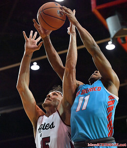 LAS CRUCES, NEW MEXICO - NOVEMBER 21, 2019:  Ivan Aurrecoechea #15 of the New Mexico State Aggies and JJ Caldwell #11 of the New Mexico Lobos battle for a rebound during their game at The Pan American Center on November 21, 2019 in Las Cruces, New Mexico. The Lobos defeated the Aggies 78-77.  (Photo by Sam Wasson/bleedCrimson.net)