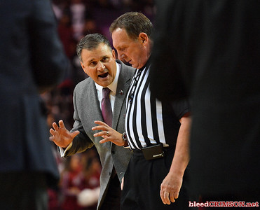 LAS CRUCES, NEW MEXICO - NOVEMBER 20, 2019:  Head coach Chris Jans of the New Mexico State Aggies talks to referee David Hall during his team's game against the New Mexico Lobos  at The Pan American Center on November 20, 2019 in Las Cruces, New Mexico. The Lobos defeated the Aggies 78-77.  (Photo by Sam Wasson/bleedCrimson.net)