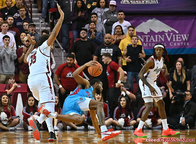 LAS CRUCES, NEW MEXICO - NOVEMBER 20, 2019:  JaQuan Lyle #5 of the New Mexico Lobos is fouled by Johnny McCants #35 of the New Mexico State Aggies during their game at The Pan American Center on November 20, 2019 in Las Cruces, New Mexico. The Lobos defeated the Aggies 78-77.  (Photo by Sam Wasson/bleedCrimson.net)
