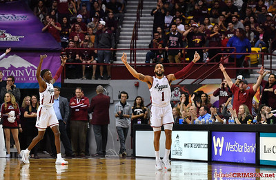 LAS CRUCES, NEW MEXICO - NOVEMBER 20, 2019:  Shunn Buchanan #1 and Jabari Rice #10 of the New Mexico State Aggies urge the crowd to make noise during their game against the New Mexico Lobos  at The Pan American Center on November 20, 2019 in Las Cruces, New Mexico. The Lobos defeated the Aggies 78-77.  (Photo by Sam Wasson/bleedCrimson.net)