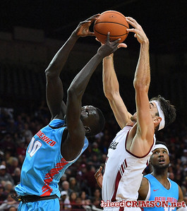 LAS CRUCES, NEW MEXICO - NOVEMBER 20, 2019:  Makuach Maluach #10 of the New Mexico Lobos and Ivan Aurrecoechea #15 of the New Mexico State Aggies battle for a rebound during their game at The Pan American Center on November 20, 2019 in Las Cruces, New Mexico. The Lobos defeated the Aggies 78-77.  (Photo by Sam Wasson/bleedCrimson.net)