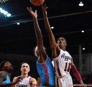 LAS CRUCES, NEW MEXICO - NOVEMBER 20, 2019:  Jabari Rice #10 of the New Mexico State Aggies shoots against Carlton Bragg Jr. #15 of the New Mexico Lobos during their game at The Pan American Center on November 20, 2019 in Las Cruces, New Mexico. The Lobos defeated the Aggies 78-77.  (Photo by Sam Wasson/bleedCrimson.net)
