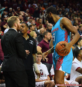 LAS CRUCES, NEW MEXICO - NOVEMBER 20, 2019:  JaQuan Lyle #5 of the New Mexico Lobos talks to AJ Harris (C) #12 of the New Mexico State Aggies during a timeout of their game at The Pan American Center on November 20, 2019 in Las Cruces, New Mexico. The Lobos defeated the Aggies 78-77.  (Photo by Sam Wasson/bleedCrimson.net)