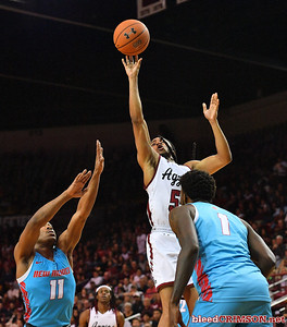 LAS CRUCES, NEW MEXICO - NOVEMBER 20, 2019:  Shawn Williams #55 of the New Mexico State Aggies shoots against JJ Caldwell #11 and Corey Manigault #1 of the New Mexico Lobos during their game at The Pan American Center on November 20, 2019 in Las Cruces, New Mexico. The Lobos defeated the Aggies 78-77.  (Photo by Sam Wasson/bleedCrimson.net)