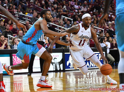 LAS CRUCES, NEW MEXICO - NOVEMBER 21, 2019:   C.J. Bobbitt #13 of the New Mexico State Aggies drives against JaQuan Lyle #5 of the New Mexico Lobos during their game at The Pan American Center on November 21, 2019 in Las Cruces, New Mexico. The Lobos defeated the Aggies 78-77.  (Photo by Sam Wasson/bleedCrimson.net)