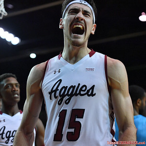LAS CRUCES, NEW MEXICO - NOVEMBER 20, 2019:  Ivan Aurrecoechea #15 of the New Mexico State Aggies celebrates after getting fouled while scoring on a layup against the New Mexico Lobos during their game at The Pan American Center on November 20, 2019 in Las Cruces, New Mexico. The Lobos defeated the Aggies 78-77.  (Photo by Sam Wasson/bleedCrimson.net)