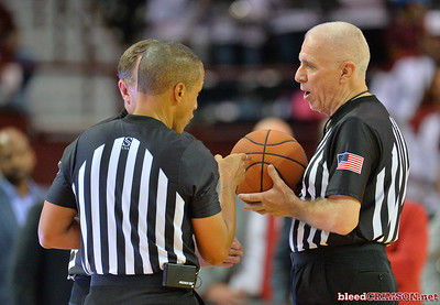 LAS CRUCES, NEW MEXICO - NOVEMBER 21, 2019:  Referee Shawn Lehigh (R) and Verne Harris talk after reviewing a call during a game between the New Mexico State Aggies and the New Mexico Lobos at The Pan American Center on November 21, 2019 in Las Cruces, New Mexico. The Lobos defeated the Aggies 78-77.  (Photo by Sam Wasson/bleedCrimson.net)