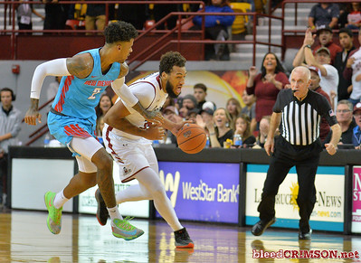 LAS CRUCES, NEW MEXICO - NOVEMBER 21, 2019:  Johnny McCants #35 of the New Mexico State Aggies drives against Vance Jackson #2 of the New Mexico Lobos during their game at The Pan American Center on November 21, 2019 in Las Cruces, New Mexico. The Lobos defeated the Aggies 78-77.  (Photo by Sam Wasson/bleedCrimson.net)