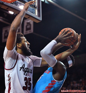 LAS CRUCES, NEW MEXICO - NOVEMBER 20, 2019:  Johnny McCants #35 of the New Mexico State Aggies battle Carlton Bragg Jr. #15 of the New Mexico Lobos for a rebound during their game at The Pan American Center on November 20, 2019 in Las Cruces, New Mexico. The Lobos defeated the Aggies 78-77.  (Photo by Sam Wasson/bleedCrimson.net)