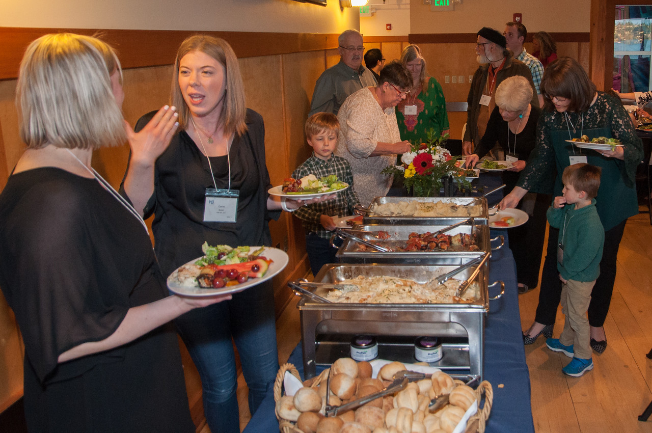 Ona Johnson Spaniola and Carrie Bohm on the Buffet Line. Remember, never get between the athletes and the food!