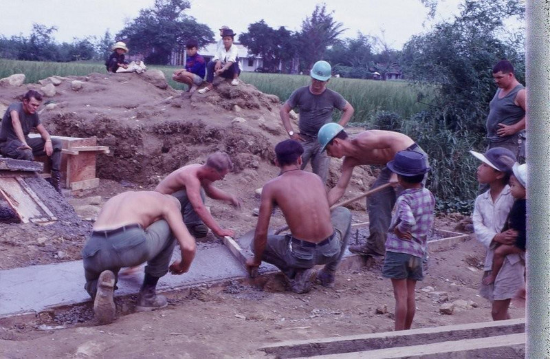 MCB-10 Crew Building Approaches to a Bridge Built by Another Battalion