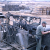 Inspection of Enemy Mortar Damage to Truck-Camp Adenir 1966