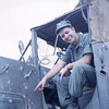Ens. Geibel Inspects Mortar Damage to Truck-Camp Adenir 1966