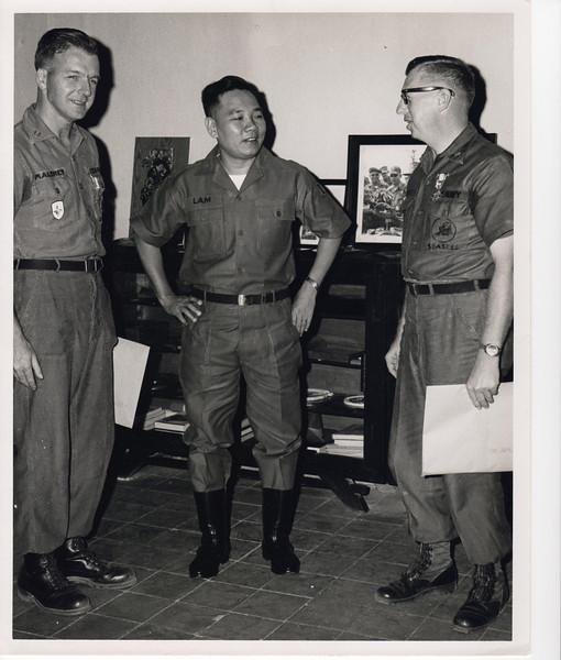 Awards ceremony; Lt. Maloney, Lt. Gen. Hoan Xuan Lam, ARVN, and Cmdr. James L. Lee, CEC, USNR (April '69).<br /> Photo by CM-2 B. D. Barter.
