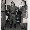 Awards ceremony; Lt. Maloney, Lt. Gen. Hoan Xuan Lam, ARVN, and Cmdr. James L. Lee, CEC, USNR (April '69).<br /> Photo by CM-2 B. D. Barter.
