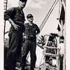 Lt. Father Maloney (L) and Cmdr. James L. Lee, CEC, USNR at a school construction site (October '68).