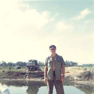 Rod Leger at Cooper Bridge-Watchtower/Bunker in the Background