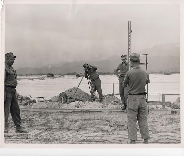1969 MCB-22 survey crew setting blue tops for a concrete slab.  Photo taken Jan69