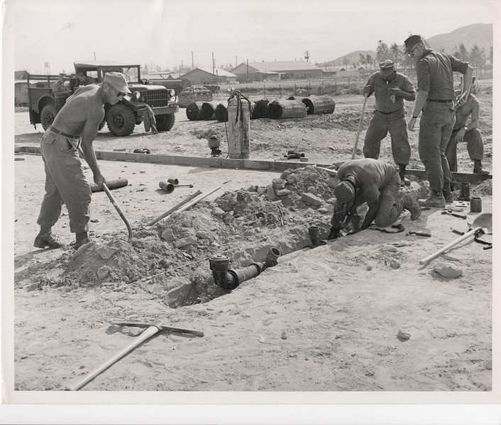 1969 Putting in the waste water piping on a building project.