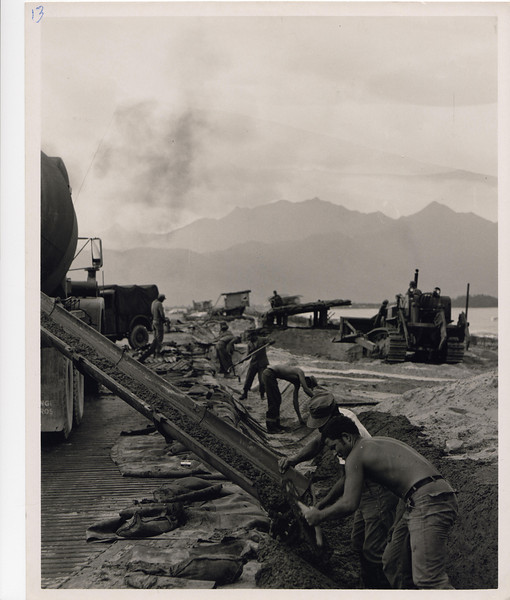 1968 Constructing a drainage flum for the Army.  Notice the heavy plastic material used to keep the sand from the ditch.  Photo taken Nov68.