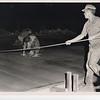 1959 Finishing concrete after dark.  Photo taken Jan69.
