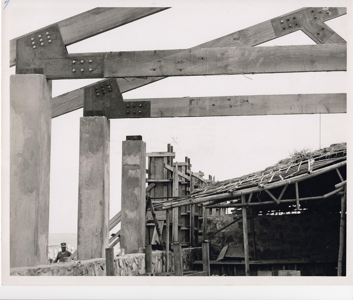 1969 Camp Improvement.  The EM Club's old roof gives way to MCB-22's new wood roof truss and concrete column design.