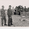 1969 Pictured at a Civic Action Project, 2nd Class Petty Officer Walker and Lcdr. Clifford Taylor, Chaplain, working on the projects such as Hoa Khanh Vocation School Complex.  Vietnamese labor was used extensively on these projects.