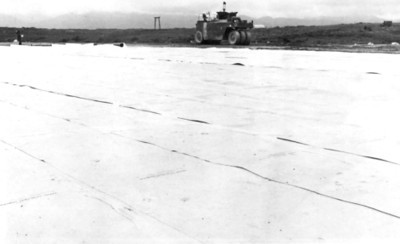 Flat sheet section of Mo-Mat was abandoned and soil-cemented.