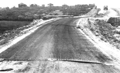 Section of Camp Evans interior road covered with Mo-Mat. 0.085 inch thick Mo-Mat was used on roads-0.042 thick Mo-Mat was used on the runway.
