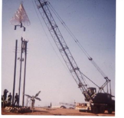 Crane Operator Jim Piccotti Lifting The Wire-made Christmas Tree.