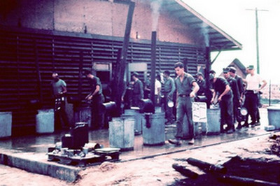 Cleaning food trays at Chow Hall - '66 - Phu Bai.