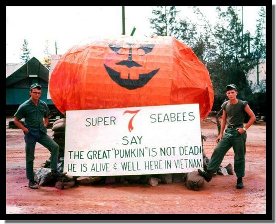 """My friends EA-3 Mike Wagner and PCSN Carroll Broussard built the pumpkin and I did the sign.<br /> <br /> Camp Adeniir, Danang, RVN, '67.<br /> <br /> MCB-7 recreated Charles Schultz's """"Great Pumpkin"""" with wire mesh and an old parachute at the main entrance to our camp along Hwy 13.  It was a traffic stopper with military vehicles and personnel stopping to admire and take photos.<br /> The photo looks like it was taken yesterday, and sometimes it seems as if it was yesterday.<br /> <br /> CAN DO.  Ray Cochran"""