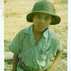 """MY """"mascot"""" wearing a spent M-60 ammo belt I made for him.  We were never ambushed by the VC when the kids were there with us on the jobsite.  This little boy will be in his 50's today.  Wouldn't it be really something if somehow he was found and contacted me?  I hope he is alive and well today."""