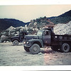 At the DaNang East Rock Quarry over by Monkey Mountain ARVN Navy Base, all our trucks got the loads of rock that we transported from 10-20 miles south on QL-1 through heavy traffic to our daily-expanding jodsite, This is my 15-ton and another 5-ton truck waiting to get loaded