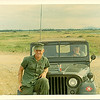 EO-1 Reardon in his jeep ingoring my picture-taking with Jim Wheat. Jim did a hitch in the Marines before transferring to the Seabees