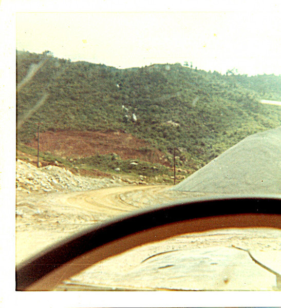 A through-the-steering-wheel view of the  inside road in the quarry