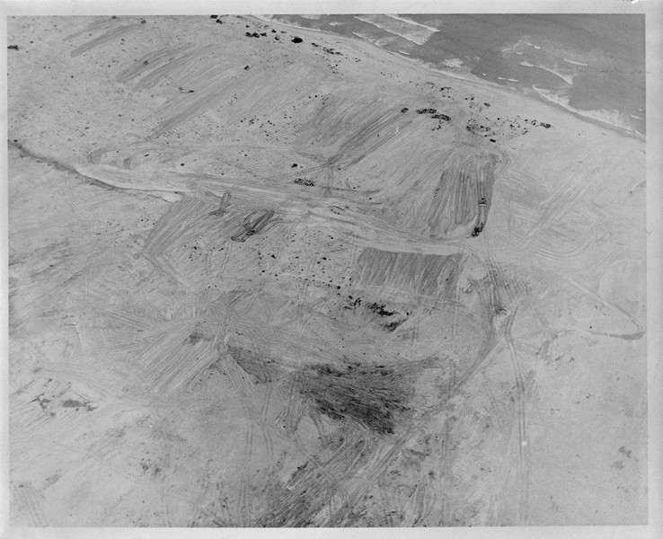 NMCB-74 preparing the 122 acre site for Project Beaver...the future site of a helicopter maitenance facility for the U.S. Army First Air Cavalry Division. The project was begun on 18 December 1967 and turned over to the 1st Cav (on time) on 15 January 1968 with an assist from 300 men from five other NMCB's in the area.<br /> <br /> CAN DO<br /> <br /> Thanks to LCDR Gene Thomas for the photo