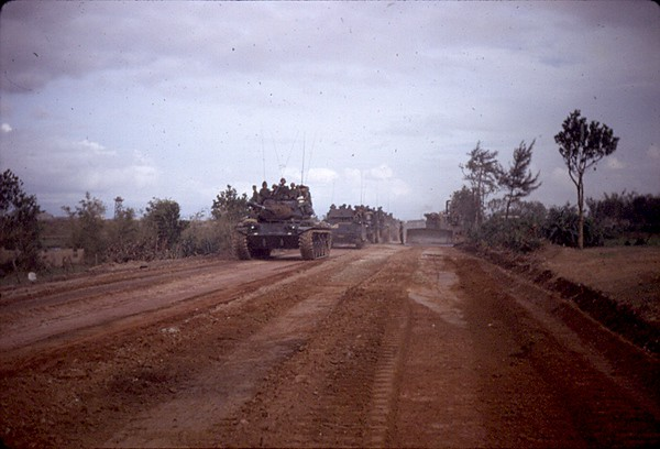 Route 1 Between Dong Ha and Quang Tri. Security tower for Dong Ha Combat Base can be seen on the left